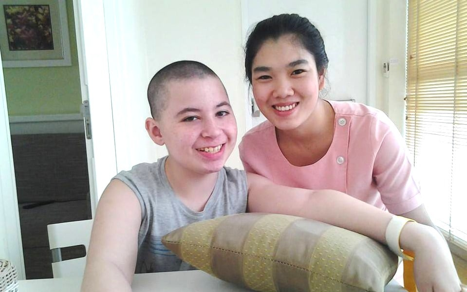 CP patient Renzo with nurse during stem cell treatment